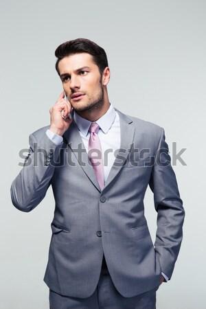 Retrato pensativo jóvenes empresario traje mirando Foto stock © deandrobot