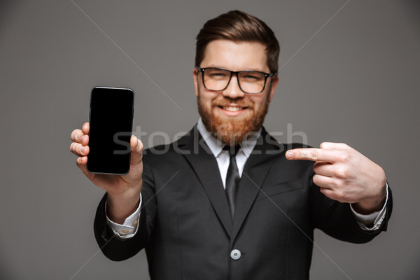 Portrait of a satisfied young businessman Stock photo © deandrobot