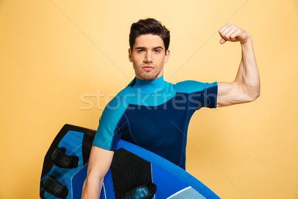 Portrait of a confident young man dressed in swimsuit Stock photo © deandrobot
