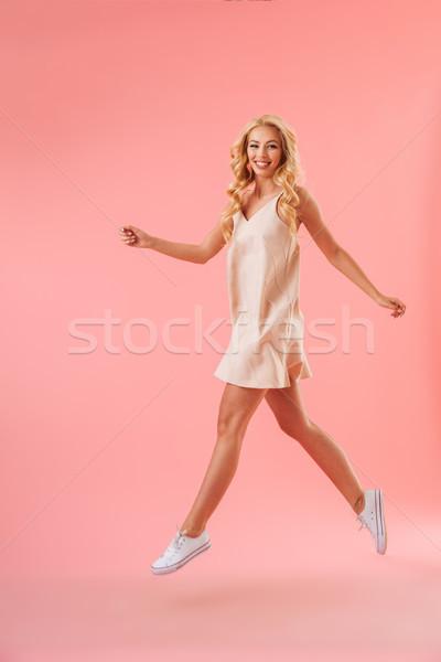 Teljes alakos kép boldog szőke nő ruha fut Stock fotó © deandrobot
