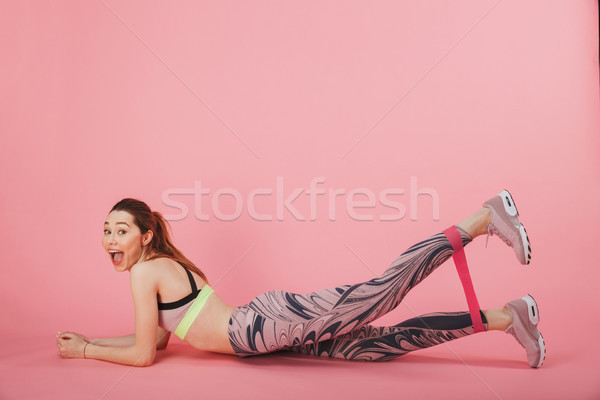 Side view of happy sportswoman lying on the floor Stock photo © deandrobot