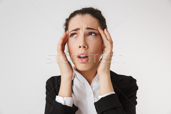Sad displeased young business woman with headache Stock photo © deandrobot