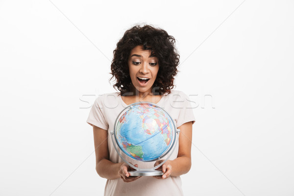 Portrait of a joyful young afro american woman Stock photo © deandrobot