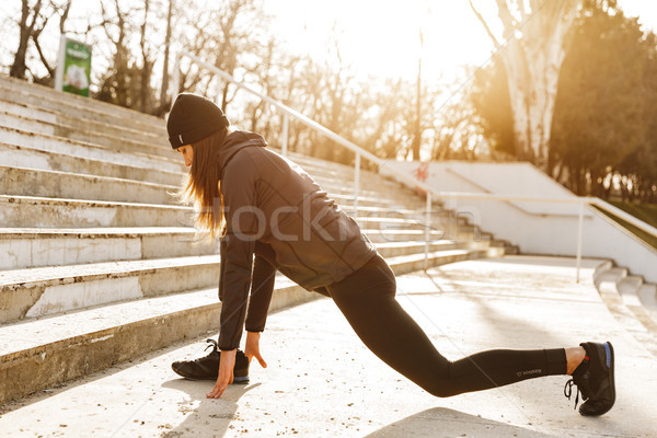 Image of disabled athletic girl in sportswear, exercising and st Stock photo © deandrobot