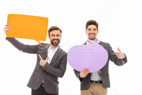 Portré kettő elégedett üzletemberek tart üres Stock fotó © deandrobot