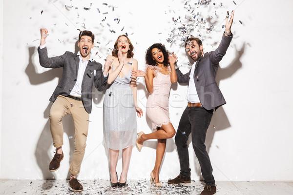 Csoport boldog jólöltözött emberek ünnepel együtt Stock fotó © deandrobot