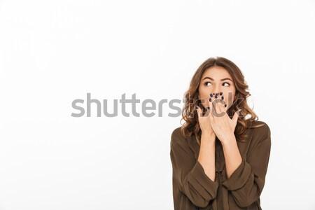 Portré megrémült fiatal nő befogja száját kezek izolált Stock fotó © deandrobot