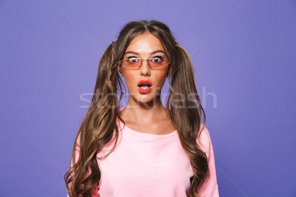 Portrait of a shocked girl in sweatshirt in sunglasses Stock photo © deandrobot