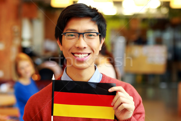 Derűs ázsiai diák tart zászló Németország Stock fotó © deandrobot