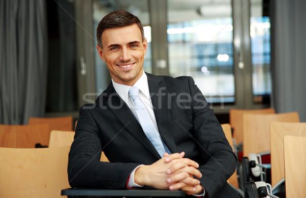 Boldog üzletember áll konferencia előcsarnok üzlet Stock fotó © deandrobot