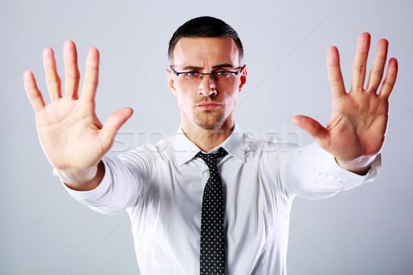 Empresário sinal de parada tanto mãos cinza Foto stock © deandrobot