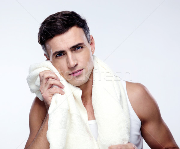 Handsome man drying his face with towel Stock photo © deandrobot