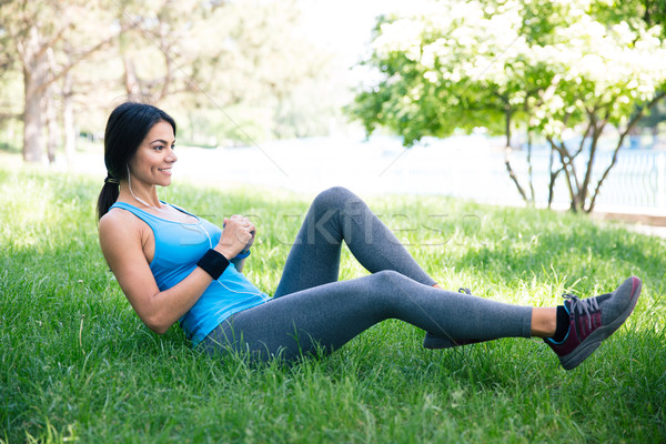 Stock photo: Sporty woman doing stretching exercsises in park