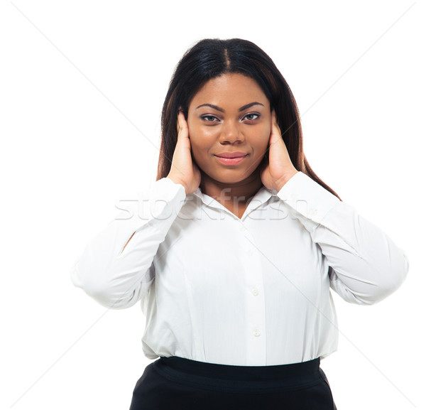 Afro american businesswoman covering her ears Stock photo © deandrobot