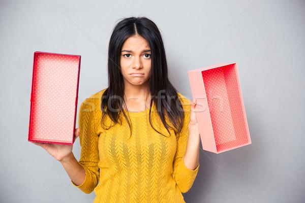 Unhappy woman holding empty gift box Stock photo © deandrobot