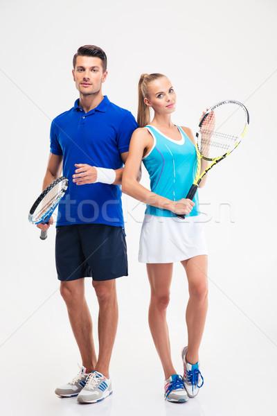 Sportok pár áll teniszütő portré gyönyörű Stock fotó © deandrobot