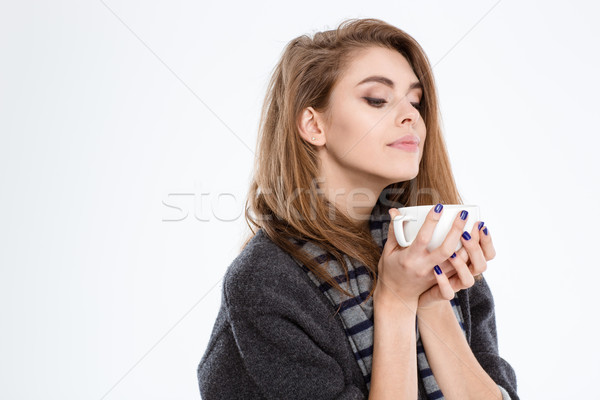 Cute woman smelling cup with coffee Stock photo © deandrobot