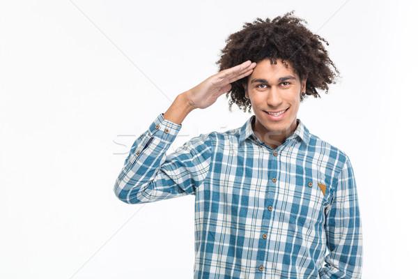 Happy afro american man saluting Stock photo © deandrobot