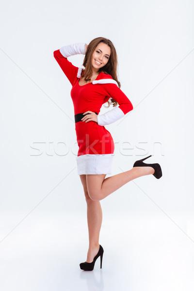 Smiling woman in santa claus cloth Stock photo © deandrobot