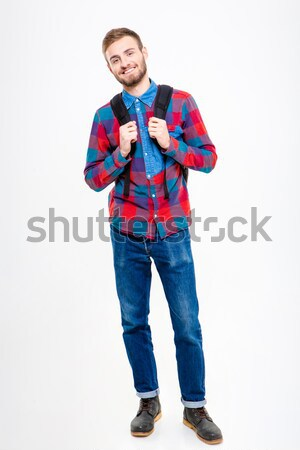 Happy male student holding books Stock photo © deandrobot