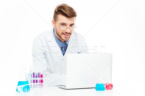 химик используя ноутбук компьютер счастливым лаборатория ноутбука Сток-фото © deandrobot