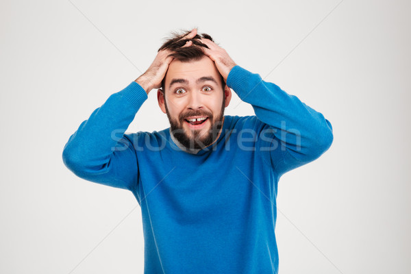 Cheerful amazed man looking at camera  Stock photo © deandrobot