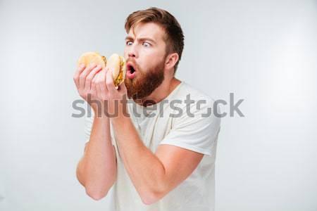возбужденный красивый мужчина борода еды гамбургер Сток-фото © deandrobot