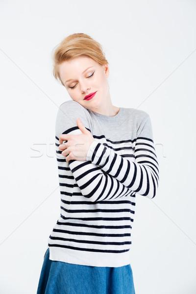 Nyugodt nő csukott szemmel áll izolált fehér Stock fotó © deandrobot