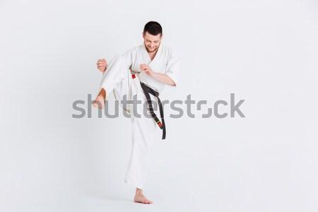 молодым человеком кимоно изолированный белый спортивных Сток-фото © deandrobot