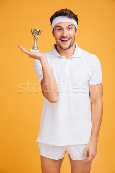 Portré boldog fiatal sportoló tart trófea Stock fotó © deandrobot