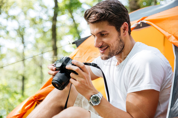 Man tourist taking photos with modern photo camera in forest Stock photo © deandrobot