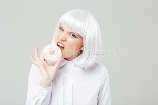 Arrabbiato bella capelli biondi mangiare fresche Foto d'archivio © deandrobot