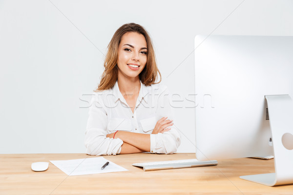 Businesswoman with arms folded Stock photo © deandrobot