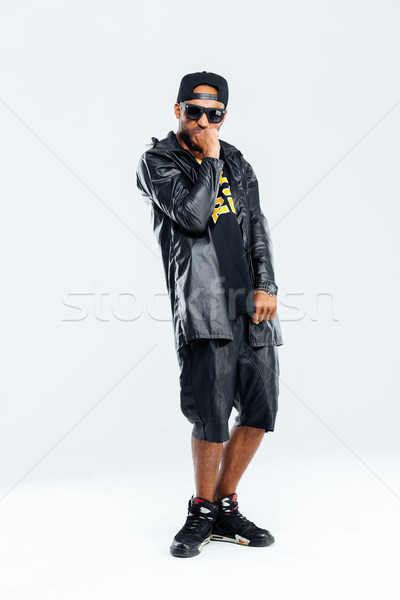 Stylish afro american man looking at camera and posing Stock photo © deandrobot