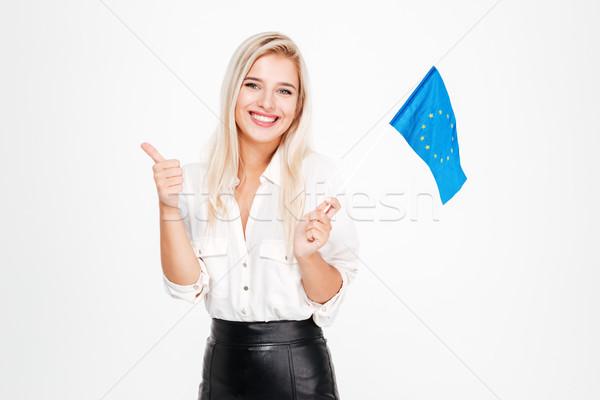 üzletasszony tart zászló európai szövetség mutat Stock fotó © deandrobot