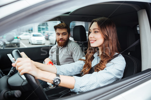 side portrait of fashion couple in car Stock photo © deandrobot
