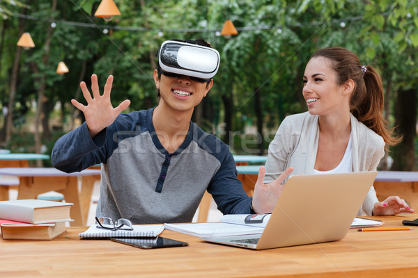 пару виртуальный реальность очки смеясь улице Сток-фото © deandrobot
