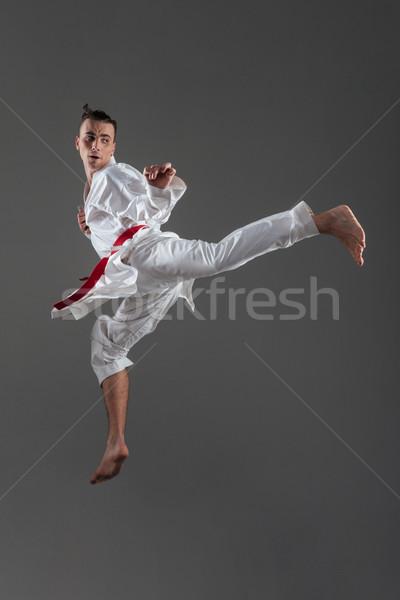 Jóképű fiatal sportoló kimonó gyakorlat karate Stock fotó © deandrobot