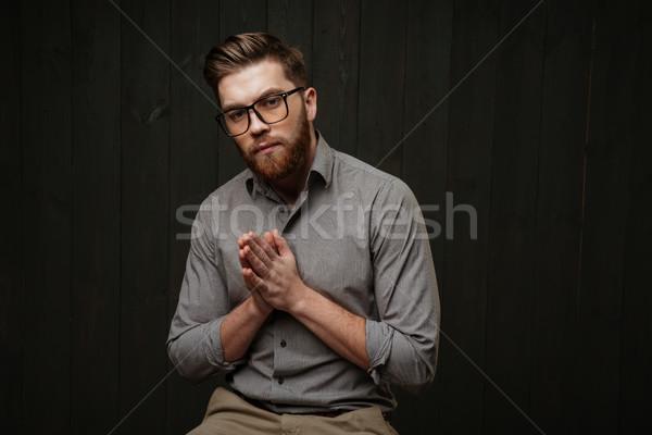 портрет молодым человеком очки сидят молиться молодые Сток-фото © deandrobot