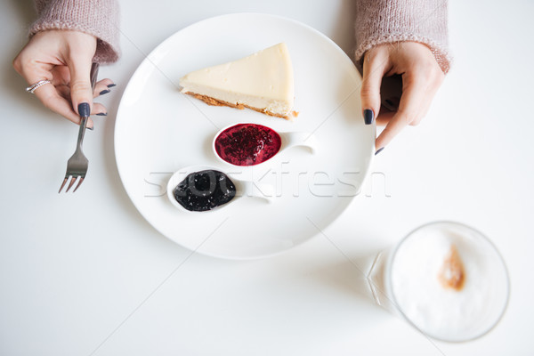 Top view image of young lady in cafe having breakfast Stock photo © deandrobot