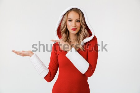 Cheerful charming young woman making selfie using smartphone Stock photo © deandrobot