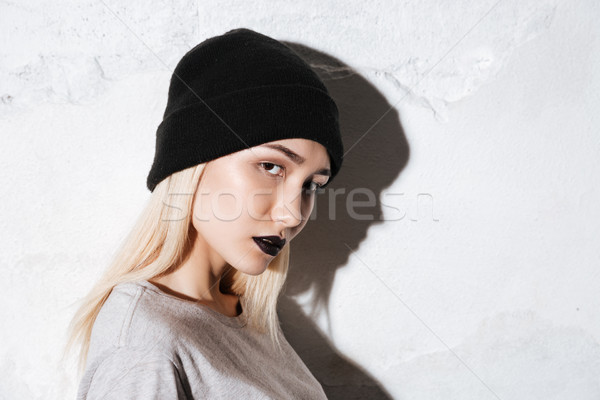 Side view of Young Hipster looking at camera Stock photo © deandrobot