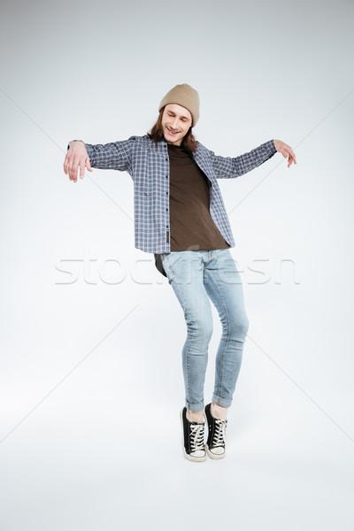 Vertical image of hipster posing in studio Stock photo © deandrobot