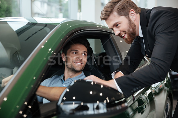 Profi férfi kereskedő elad autó vásárló Stock fotó © deandrobot