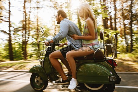 Loving couple man on scooter with girlfriend outdoors Stock photo © deandrobot