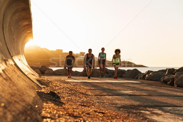 Foto quattro sport persone eseguire Foto d'archivio © deandrobot