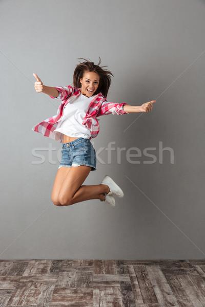 портрет довольно прыжки девушки случайный носить Сток-фото © deandrobot