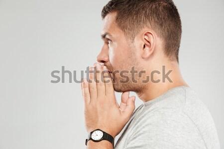 Concentré homme image jeunes gris tshirt Photo stock © deandrobot