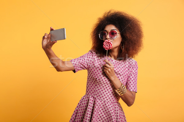 Portrait of an attractive afro american woman Stock photo © deandrobot