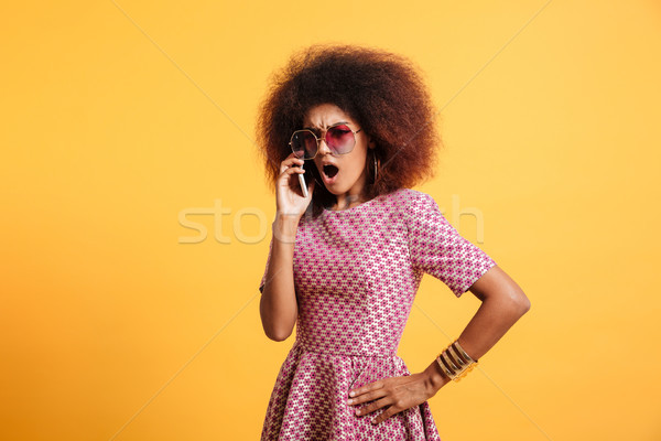 Portrait of an angry furious afro american woman Stock photo © deandrobot